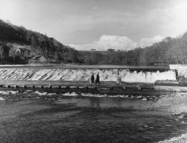 A fine impression of the then newly built Lopwell Reservoir Dam, on the River Tavy, Devon, England, which was built to supplement the water supply of the city of Plymouth. Date: completed 1953