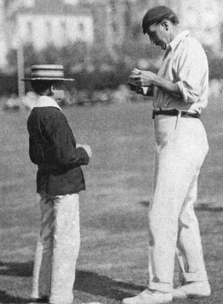 Lord Hawke, captain of the Yorkshire cricket team, signs an autograph for a young admirer during the match between county champions Yorkshire and an England XI which was played at Hastings between the 5th and 7th September, 1901 Date: September 1901