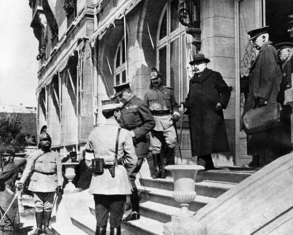 Lord Herbert Kitchener (1850-1916) and others leaving a conference in France during the shell shortage crisis, First World War. Date: circa 1915