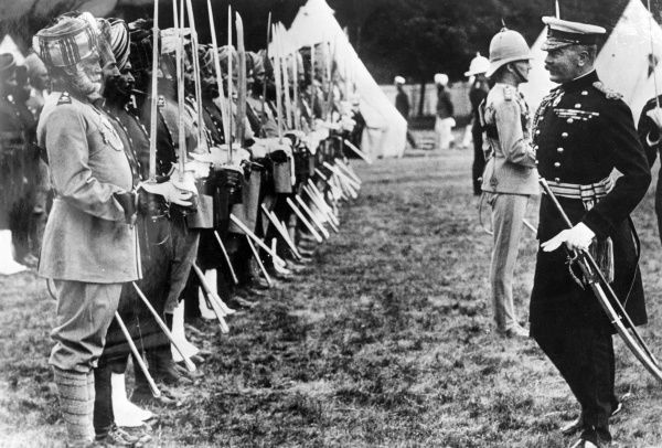 Lord Herbert Kitchener (1850-1916) reviewing Indian troops during the First World War. 800,000 Indian troops fought in the war: nearly 48,000 were killed or missing and 65,000 wounded. 13,000 medals were won, including 12 VCs. Date: 1914-1915