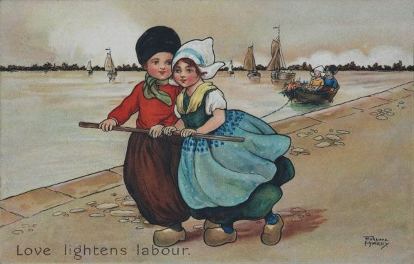 Love lightens labour. A young couple walk along the bay. They pull a boat behind them