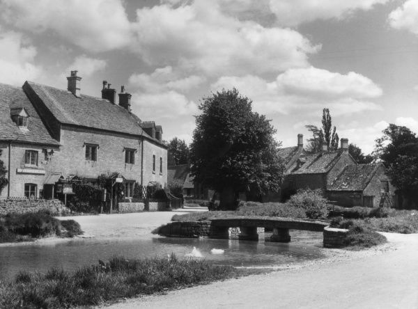 The tranquil village of Lower Slaughter, Gloucestershire, England. Date: 1930s