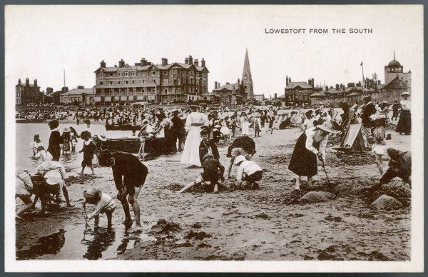 Children engaged in all kinds of activity on the sands at Lowestoft, Suffolk