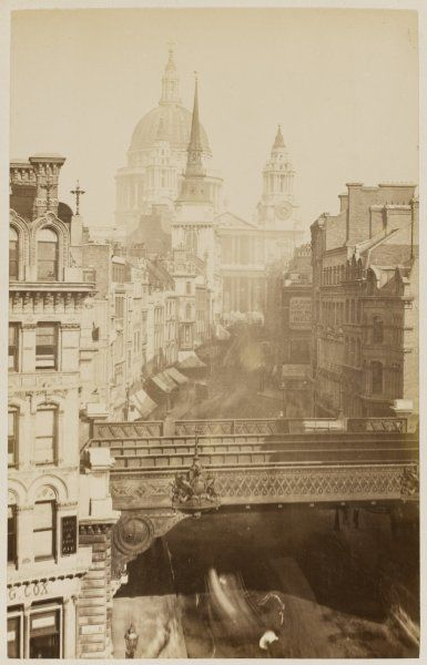 Ludgate Hill from Ludgate Circus, looking towards St Paul's Cathedral. The bridge was built in 1866 and removed in 1989