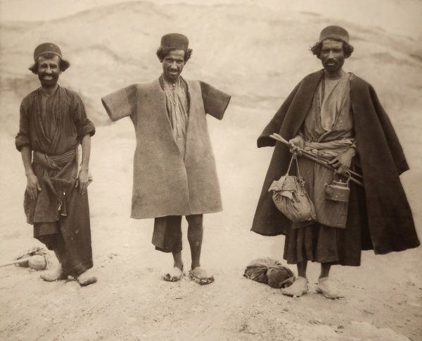 Lur Tribesmen in felt coats. Lurs (also Lors, Lori) are an Iranian people living mostly in the south-west of the country