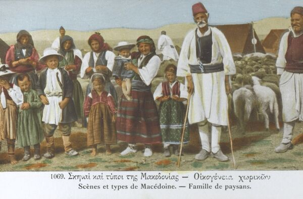 Macedonian regional farmer type and his large family, flock of sheep and their tents. Date: circa 1910s