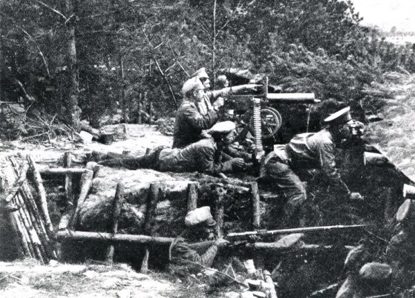 A machine gun section, probably of the Austro-Hungarian army, in action in a forest on the Russian Front during the First World War. Date: 1914-1918