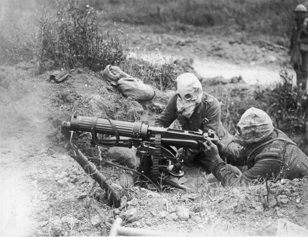 British machine gunners using a Vickers Gun and wearing their gas masks, near Ovillers during the Battle of the Somme