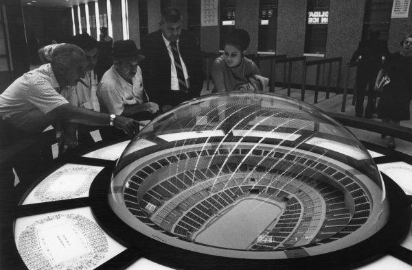 Planners pouring over a model of Madison Square Garden Arena, the famous New York sports arena designed by Charles Luckman; now known as 'MSG' or 'The Garden'. Date: opened 1968