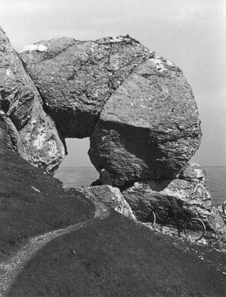 The rock formation on the Antrim Coast Road, County Antrim, Northern Ireland, known locally as 'Madman's Window'. Date: 1950s