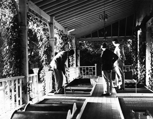 The first British miniature golf course to be opened was at Maidenhead, Berkshire, England, a full 18 hole course, sheltered under a beautiful verandah! Date: 1930s