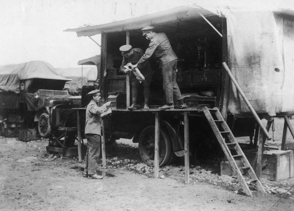 A delivery of mail to men at an ASC (Army Service Corps) travelling workshop, working behind the lines during the First World War. Date: 1914-1918