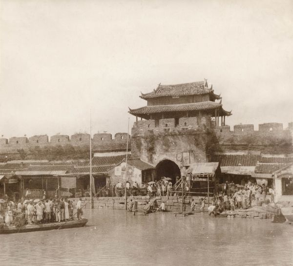 One of the main gates of Nanking, China, at the time that the city was captured by revolutionaries. The Qing Dynasty was overthrown in October 1911, the last imperial dynasty of China, and Sun Yat Sen became President of the newly formed Republic of China