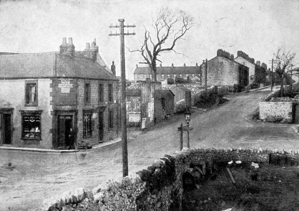 Photograph of the main street of Dove Holes, near Buxton in Derbyshire, pictured in 1913. Between 1905 and 1913 a quarter of the village population, about 250 people, emigrated to Canada