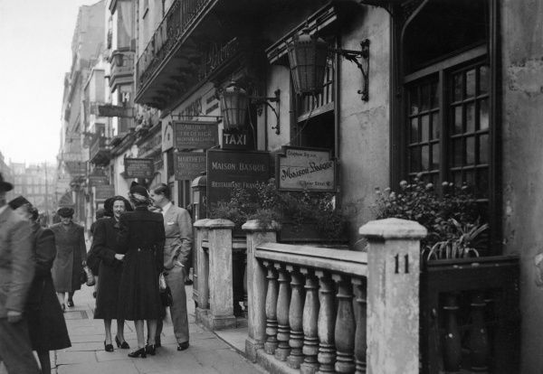 People outside the Maison Basque restaurant, 11 Dover Street, Mayfair, London, 1947 Date: 1947