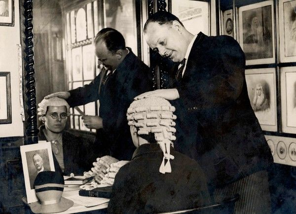 The wigmakers' firm, Messrs. Ede & Ravenscroft, prepare a wig to fit a woman barrister, whose longer hair has proved a problem with the wearing of wigs in court