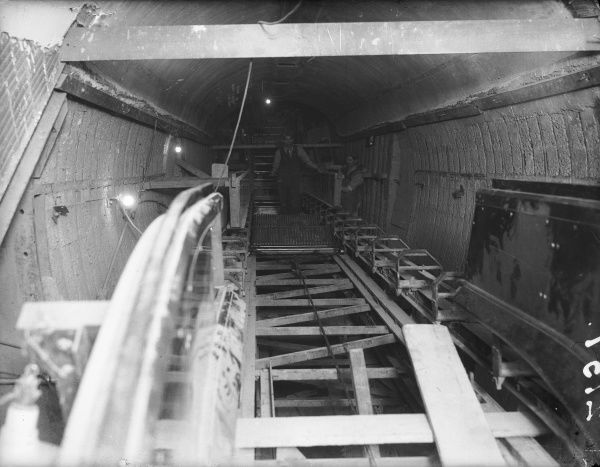 The construction of the huge escalators leading out of Tottenham Court Road underground (tube) station, central London