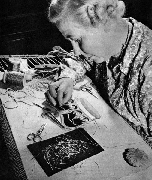 Miss Ruby Essan of Wimbledon engaged in her task of making the embroidered crown for the coronation robe of Queen Elizabeth II at the Royal School of Needlework. The Crown was incorporated in the robe just above the Royal cypher. Date: 1953