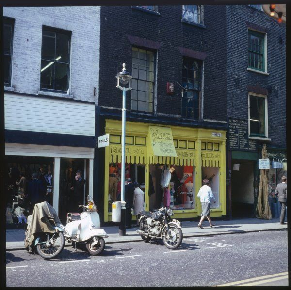 The 'Male, West One' fashion boutique for men, on Carnaby Street, London W1. The shop itself is painted in a bright canary yellow colour, whereas uptairs looks dilapidated