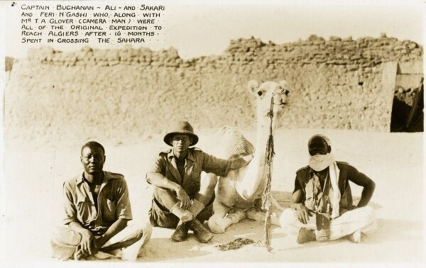 Captain Buchanan, Ali (the camel!), Sakari (Kano) and Feri N'Gashi, who along with Mr T. A. Glover (photographer) were the 'original expedition', who reached Algiers after 16 months spent in crossing the Sahara. Pictured here in Mali