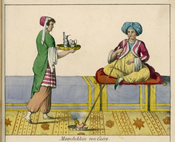 A Mameluke of Cairo, smoking a hookah, is waited on by a servant, who brings him coffee on a tray