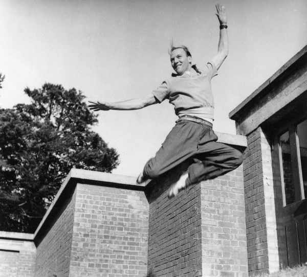 An athletic man leaping high into the air.  circa 1940s