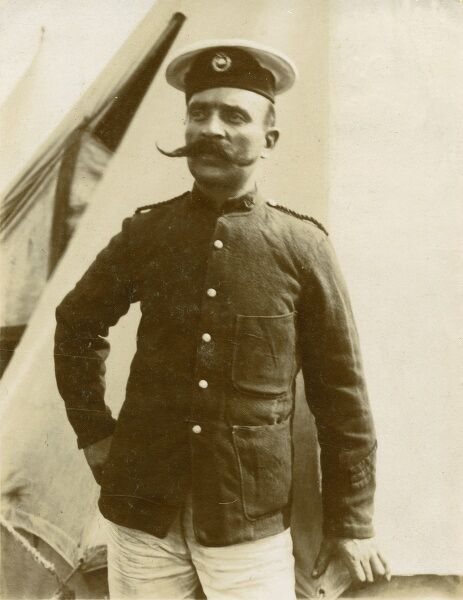 "A jolly fine example of a man in uniform (a European sailor??) standing next to his tent and sporting a particularly fine moustache. As Sparks sang so memorably: ""One Hundred Hairs make a man!&quot"