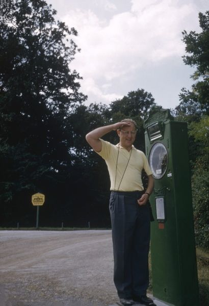 A man poses on a roadside weighing machine somewhere in the Austrian countryside