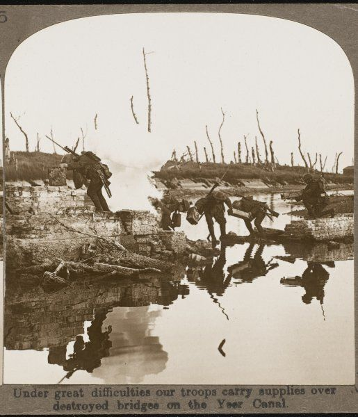 Under great difficulties, British troops carry supplies over destroyed bridges on the Yeer Canal