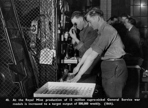 Manufacture of General Service cupro-nickel war medals at the Royal Mint, when output was increased to half a million per week.  circa 1940s