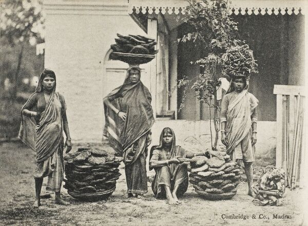 Indian manure collectors and dryers. The manure was collected off the streets, worked into brickettes, dried in the sun and then sold for fuel in place of wood and coal to the local populace. No raw materials required to be purchased!