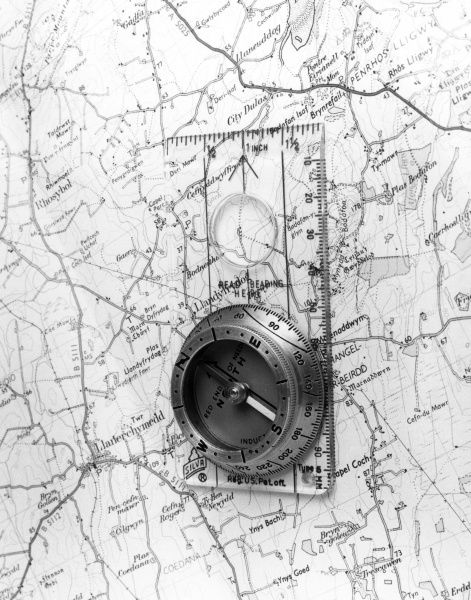 A compass on a map of the area around Lladerchymedd, Wales. Date: 1980s
