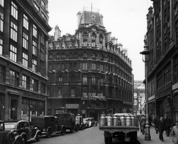 Mapleton Hotel and restaurant, Coventry Street in central London just along from Piccadilly Circus. A lorry with milk churns is in the foreground, and the building of the Automobile Association is on the left. Date: 1947