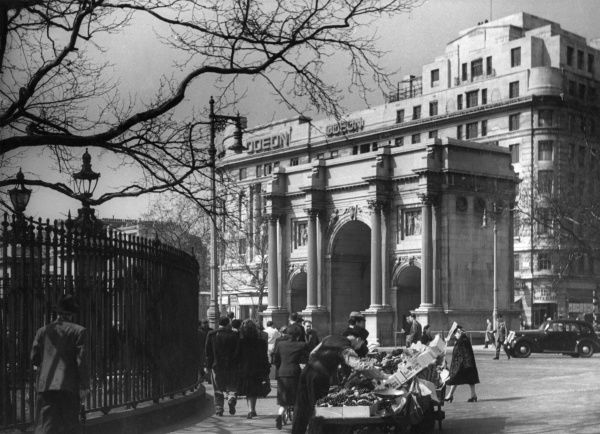 Marble Arch, designed by John Nash in 1828. Made of Carrara marble and originally intended as a grand gateway to Buckingham Palace. Date: 1940s