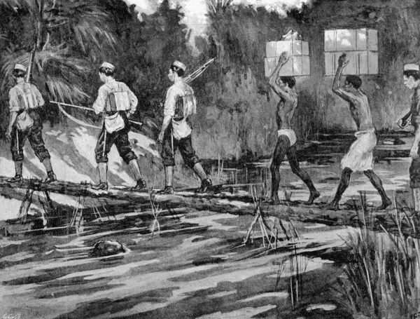 Scene depicting troops of the West Indian regiment crossing a palm tree bridge during the Mendi expedition in Sierra Leone in 1898. Date: 1898