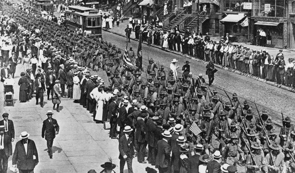 New yorkers line the streets to watch the first men march to a training camp during the first world war