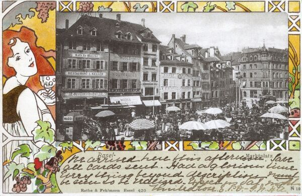 Postcard showing the Marketplace in Basel, Switzerland with a delightful and highly decorative border featuring a pretty young girl drinking wine and vineyard vines. Date: 1900