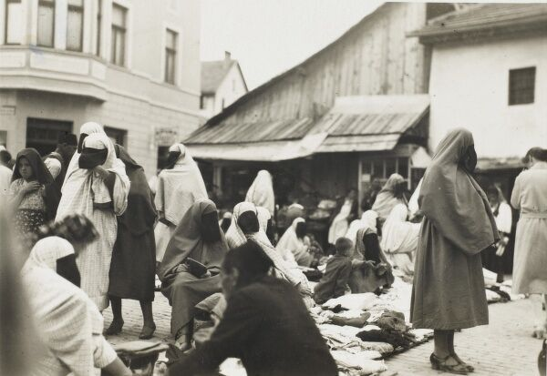 Marketplace in Sarajevo, Bosnia Herzegovina with veiled Turkic women buying and selling clothing and textiles