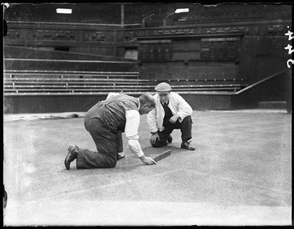 Men marking out Centre Court for the forthcoming annual Lawn Tennis tournament, Wimbledon, London, England