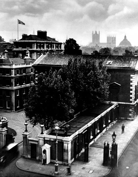 Photograph showing Marlborough House, with the personal standard of Queen Mary flying over it (left of image), London, 1936
