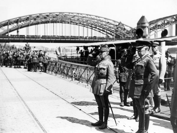 Marshal Ferdinand Foch (left) and General Sir William Robertson (right) taking the salute in Cologne, Germany, on the arrival of Foch from the steamer Bismarck.  17 May 1919