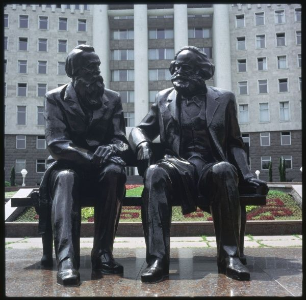 KARL MARX Statue of the German political theorist with his friend and colleague, Friedrich Engels (1820-95), somewhere in Russia