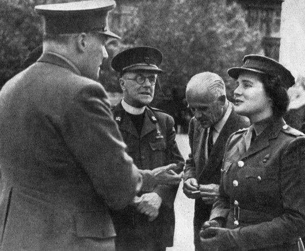 A Church Army Mobile Canteen was named 'The Second Front' by Subaltern Mary Churchill, A.T.S at a ceremony on Horse Guards Parade. Miss Churchill is seen with Captain G.A Bucknell, the Rev. Treacher, Head of the Church Army, and Mr. B de N Cruger