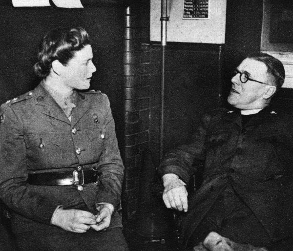 Subaltern Mary Churchill,A.TS, youngest daughter of Winston Churchill, lunched with the Reverend H.H Treacher, head of the Church Army, when she inspected hostel adjoining the headquarters. 1944