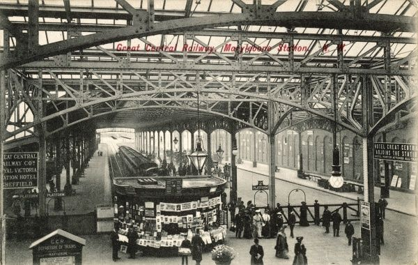Interior view of the terminus of the Great Central Railway, with a strategically placed news kiosk with your latest 'Titbits' or 'Strand&#39