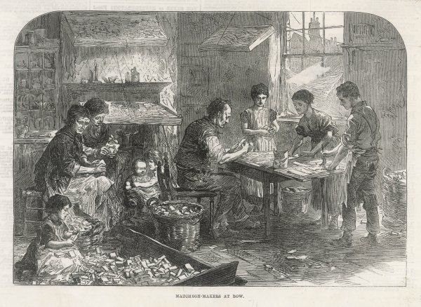 The whole family, including a number of children, make matchboxes in their home, Bow in London's east end