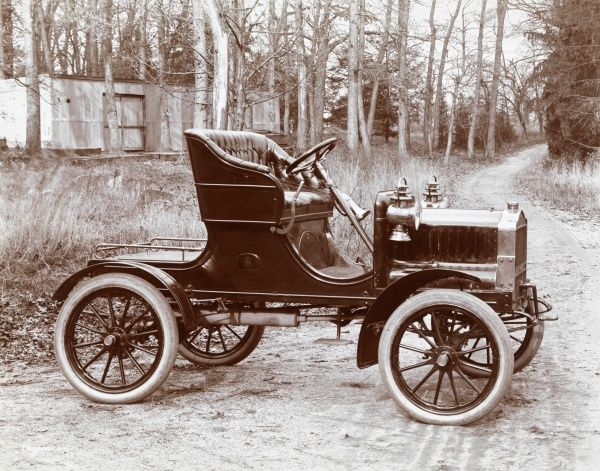 Maxwell Briscoe Motor Co. Maxwell-Briscoe automobile parked on a dirt road, presumably at or near the factory at Philips Point (near Tarrytown)