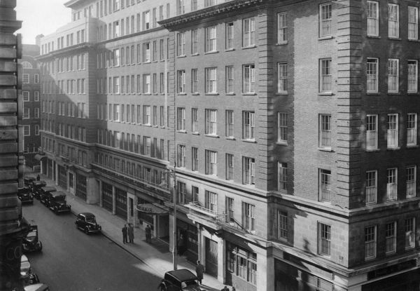 May Fair Hotel, London, with House of Bewlay on the corner of the street. Date: 1947
