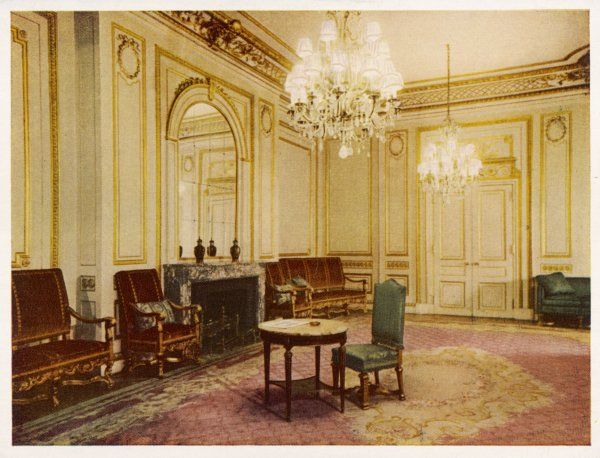 Possibly one of the general rooms open to guests at the MAYFAIR HOTEL, Berkeley Street. Comfortable chairs & settees are arranged at the edges of the room