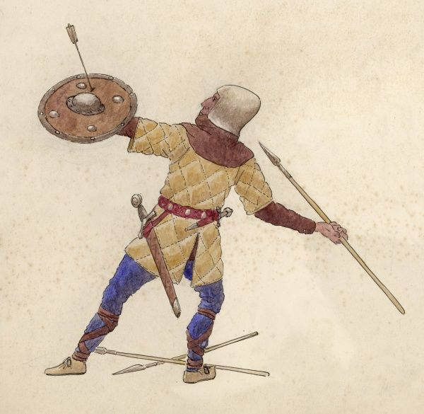A Spearman steadies himself to throw a short spear. A small round shield protects him from enemy arrows